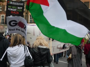 A protester waves the Palestinian flag
